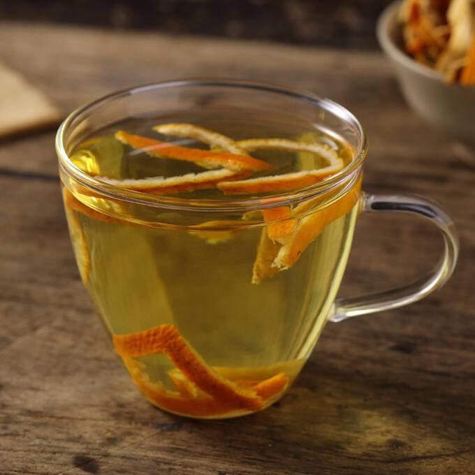 Вред и польза мандаринового чая, цедры, корочек, сока, косточек