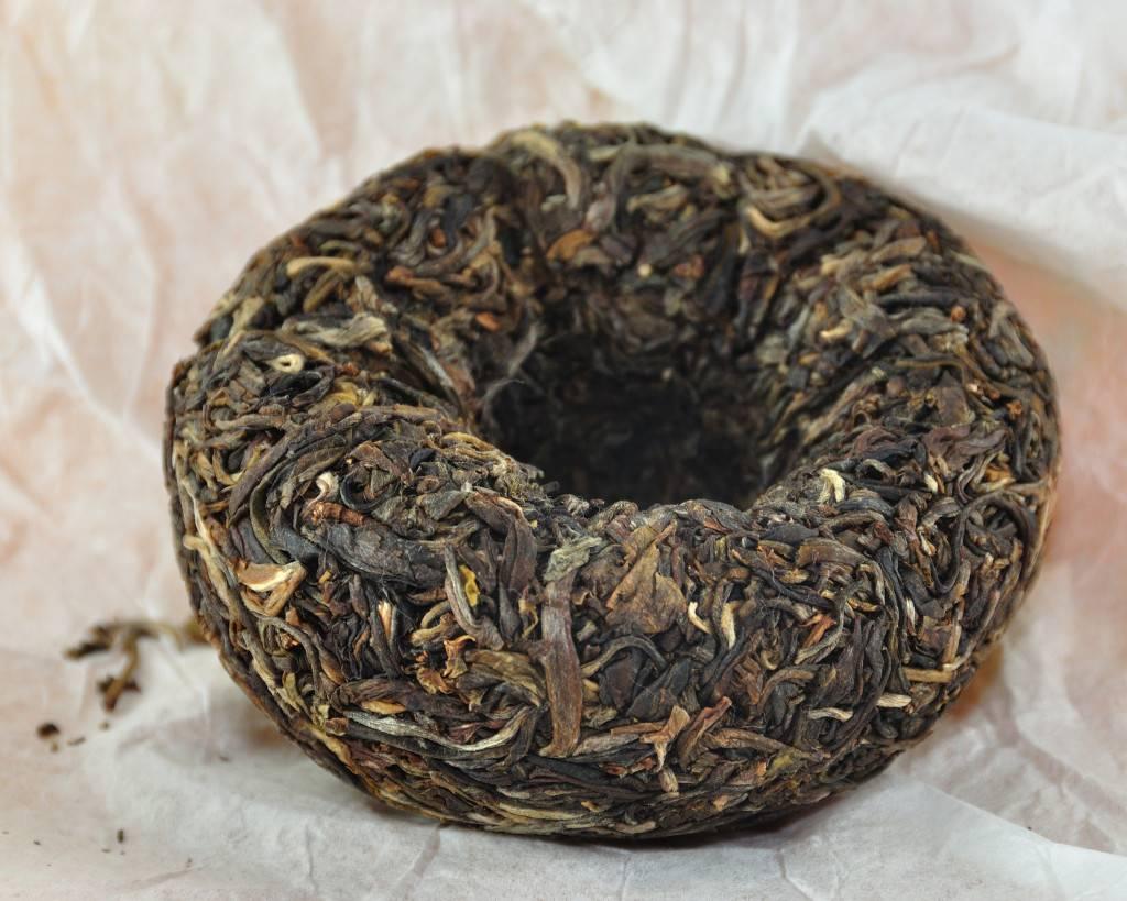 Дикий пуэр: описание чая, полезные свойства, как заваривать